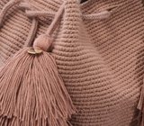 Chila Rola bucket natural materials bag in coco with tassels, close up