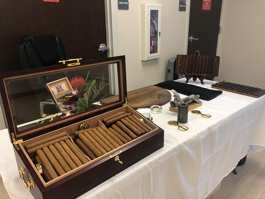 cigars on table rolled by cigar roller