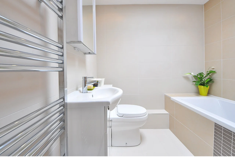 An upgraded bathroom with matt tile stickers