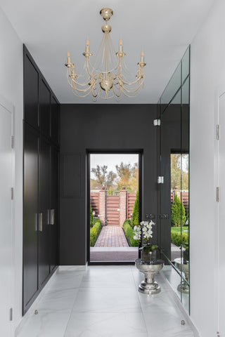 A hallway of a home with floor-length mirrors to make it look more spacious