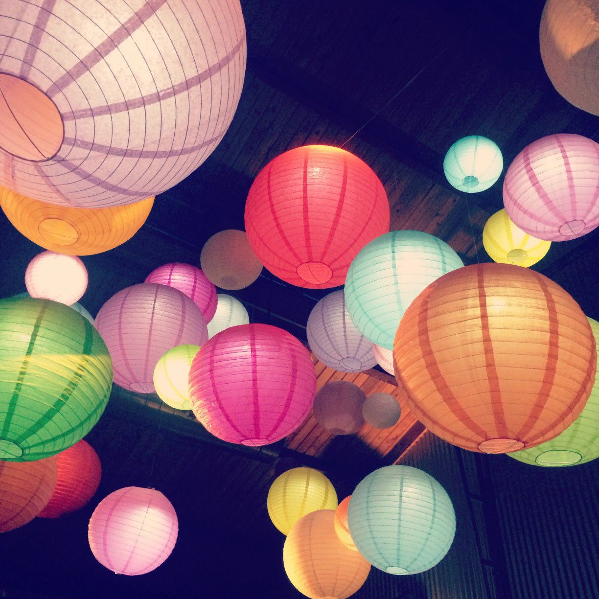 Multi Colored Paper Lanterns Hanging from Ceiling