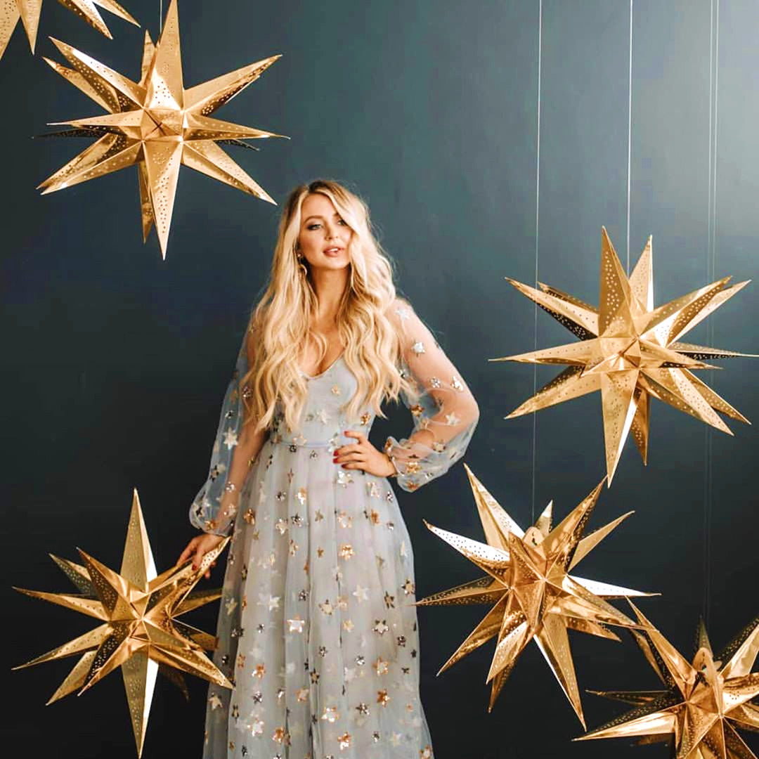 Gold Moravia Stars Hanging Around Woman