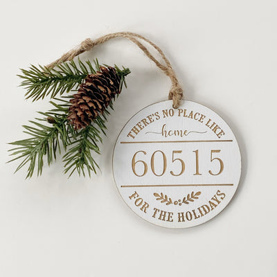 "Round wood ornament measures 3.75"" and says ""there's no place like home for the holidays- 60515"""