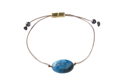Adjustable gemstone bracelet to manifest joy and laughter.