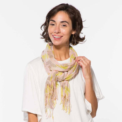 The Ana scarf is luxurious feeling and boasts colors of pink, citron, and taupe in a lovely tropical print.
