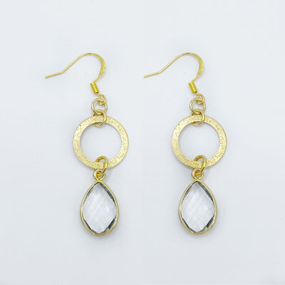 Shimmery gold circles with genuine crystal quartz teardrops make the perfect combo in this handmade gold statement earring.
