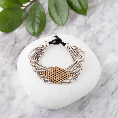 Stunning mixed metal bracelet features a gold woven diamond pattern in the middle with silver beads on the outside