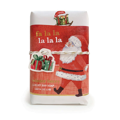 Wonderfully scented, luxurious French soaps are presented in vintage paper that pictures Santa and red highlights.