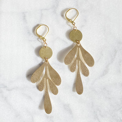 "Brass statement earrings have an organic leaf shape and hang 2.5"" long from leverback ear wires."
