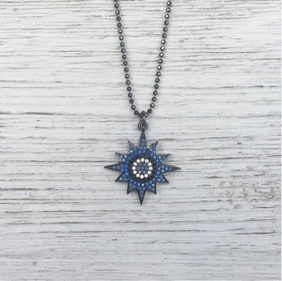 Delicate necklace featuring turquoise pave stones in the shape of a star on a faceted gunmetal chain