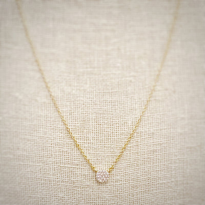 Beautiful gold pave disc floats on a gold chain for a minimalist jewelry look