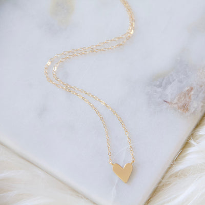 Perfectly dainty heart necklace measures 17 inches long in a gold finish with a gold filled chain.