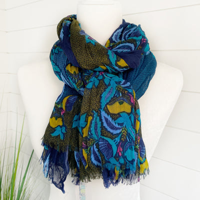 Lightweight scarf with shades of blue and gold running through and many ways to wear.