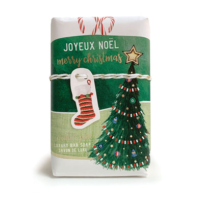 French milled gift soap is beautifully wrapped in vintage papers and pictures a Christmas tree and stocking