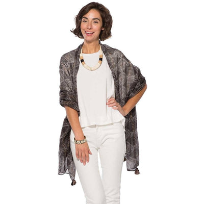 The Nene wrap has a beautiful geometric print in a washed out charcoal color lightweight fabric, making it a perfect shawl for spring and summer.
