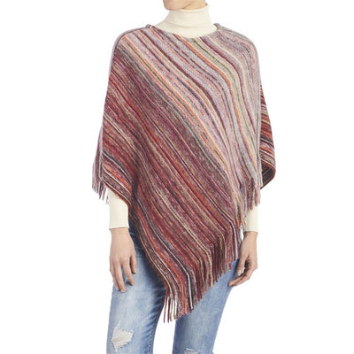 Ombre stripe poncho with fringe in rich spice tones is the soft layer you need for cold weather