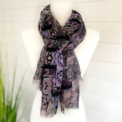 Beautiful patterned scarf with purple hues mixed with warm neutrals