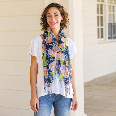 The Rosalie scarf features a painterly floral print with navy, pink, and green.