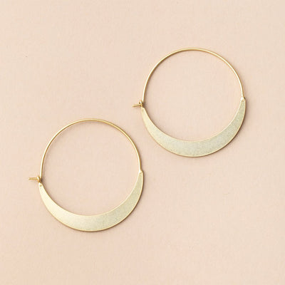 Gold hoop earrings from Scout Curated Wears that look like crescent moons.
