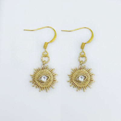 Beautiful gold sunburst earrings featuring the evil eye- an ancient symbol of protection.