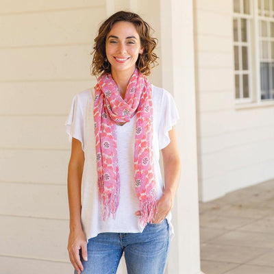 The Talia scarf offers a pretty floral pattern in pink and coral.