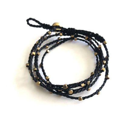Handmade braided black wrap bracelet has brass beads and can be worn as a wrap bracelet or necklace.