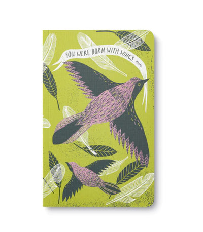 "soft cover journal states, ""You were born with wings"" which is a quote by Rumi"