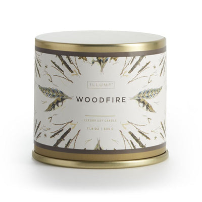 Woodfire candle from Illume features seductive cedarwood and smoke accords mix with heady patchouli leaves and warm vanilla to kindle the ultimate fireside fragrance.