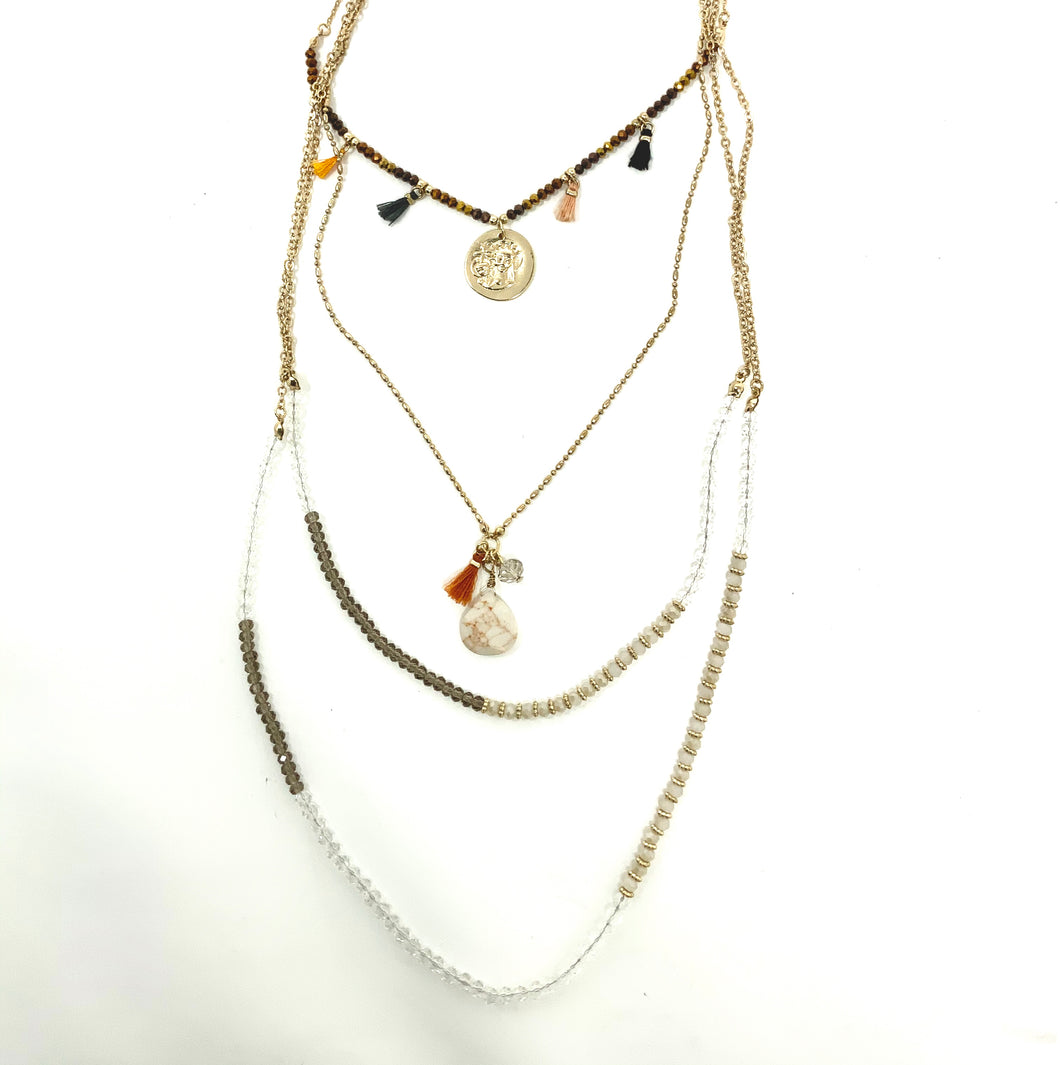 Layered coin & tassel necklace with crystals and stones