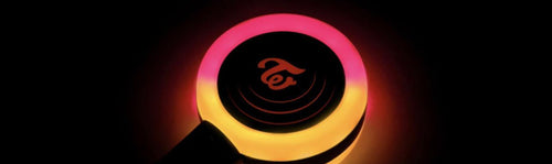 twice lightstick candy bong glowing black background
