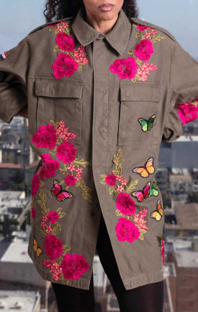 Load image into Gallery viewer, Female models front of CdJ Flower Bomb jacket, khaki-coloured military jacket with pink embroidered flowers and butterfly appliques.