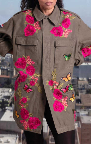 Female models front of CdJ Flower Bomb jacket, khaki-coloured military jacket with pink embroidered flowers and butterfly appliques.