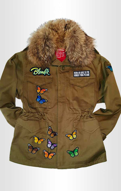 Front view of CdJ Furfly jacket with butterfly embellishments and fur collar.