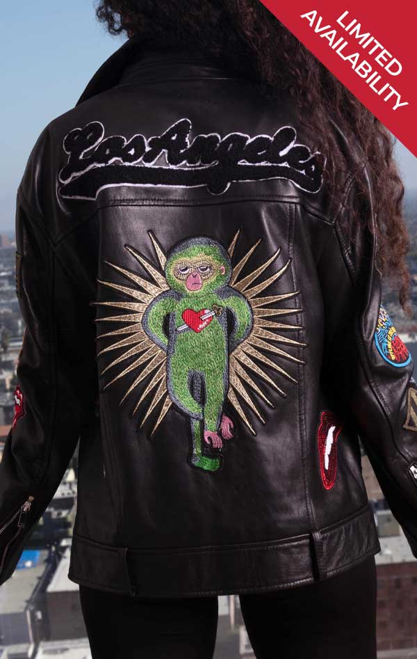 Limited availability! Female models back of black leather CdJ Hello Moto jacket with large embroidered embellishments.