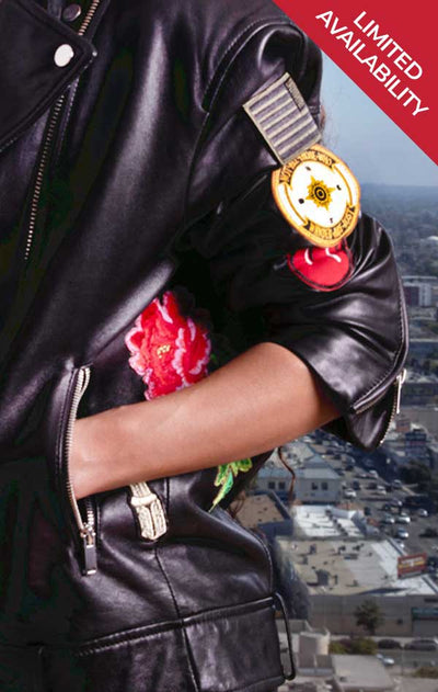 Limited availability! Model shows sleeve of CdJ Hello Moto black leather jacket with embellishments.