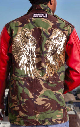 Load image into Gallery viewer, Male models back of CdJ Hides jacket with camo vest, red leather sleeves and gold angel wing embellishments.