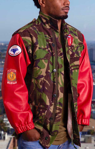 Male models front view of CdJ Hides jacket with camo vest and red leather sleeves.
