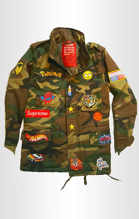 Load image into Gallery viewer, Front view of CdJ KidsRock jacket in camo print with kid-friendly embellishments.