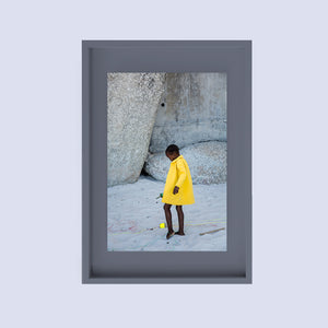 SOUTH AFRICA - CAPE TOWN - girl with yellow coat on the beach
