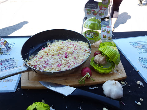 Pan Filled With Garlic Next To The Garlic Chop Product