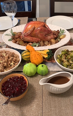 The Garlic Chop and Galic Peel on table next to Thanksgiving Turkey dinner