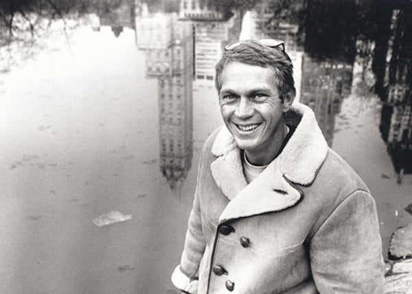 Steve McQueen wears a suede shearling coat in Central Park, New York City, 1961.