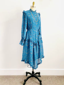 Vintage Blue Floral Dress with Ruffles and Ruched Sleeves