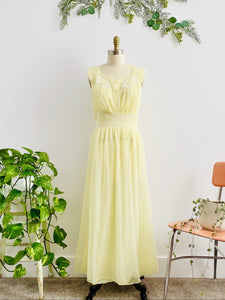 1960s Yellow sheer lingerie gown with embroidered flowers on mannequin