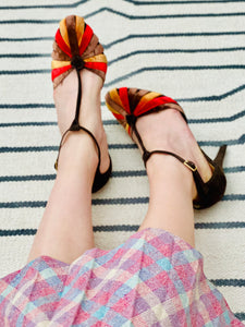 model wearing vintage 1930s style velvet NINE WEST shoes and pink plaid skirt