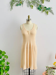 1920s peach color wool slip dress on mannequin
