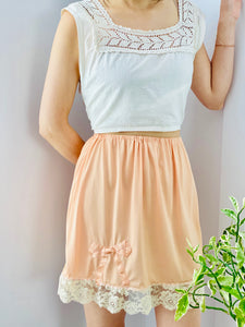 peach color 1930s nylon skirt on model