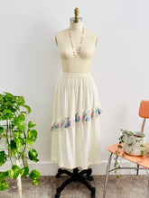 Load image into Gallery viewer, mannequin displays a vintage 1970s white embroidered cotton skirt