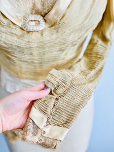 details of antique handmade buttons of pleated sleeves from an antique lace top