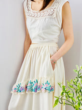 Load image into Gallery viewer, model wearing 1910s lace top and embroidered floral white skirt